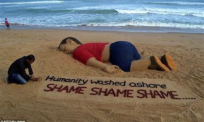 Em bé Syria (5).Tượng cát jpg
